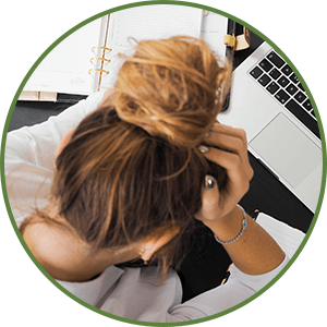 Woman stressed looking at laptop - Stress Affects Weight Loss - Dr. Tara Clapp, ND