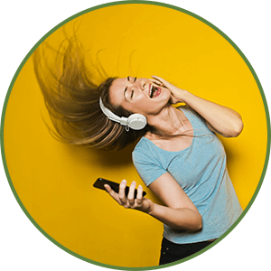 woman dancing to music wearing headphones - More Energy - Benefit of Keto Diet
