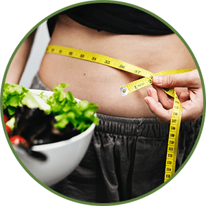 woman measuring her waist holding a salad bowl - Weight Loss - Benefit of Keto Diet