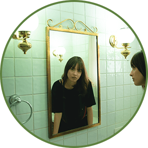 Woman Looking In Mirror - Don't Judge Yourself